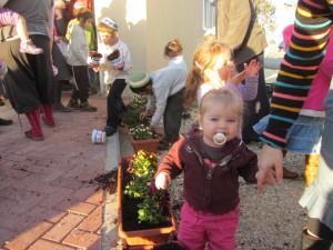 babies planting